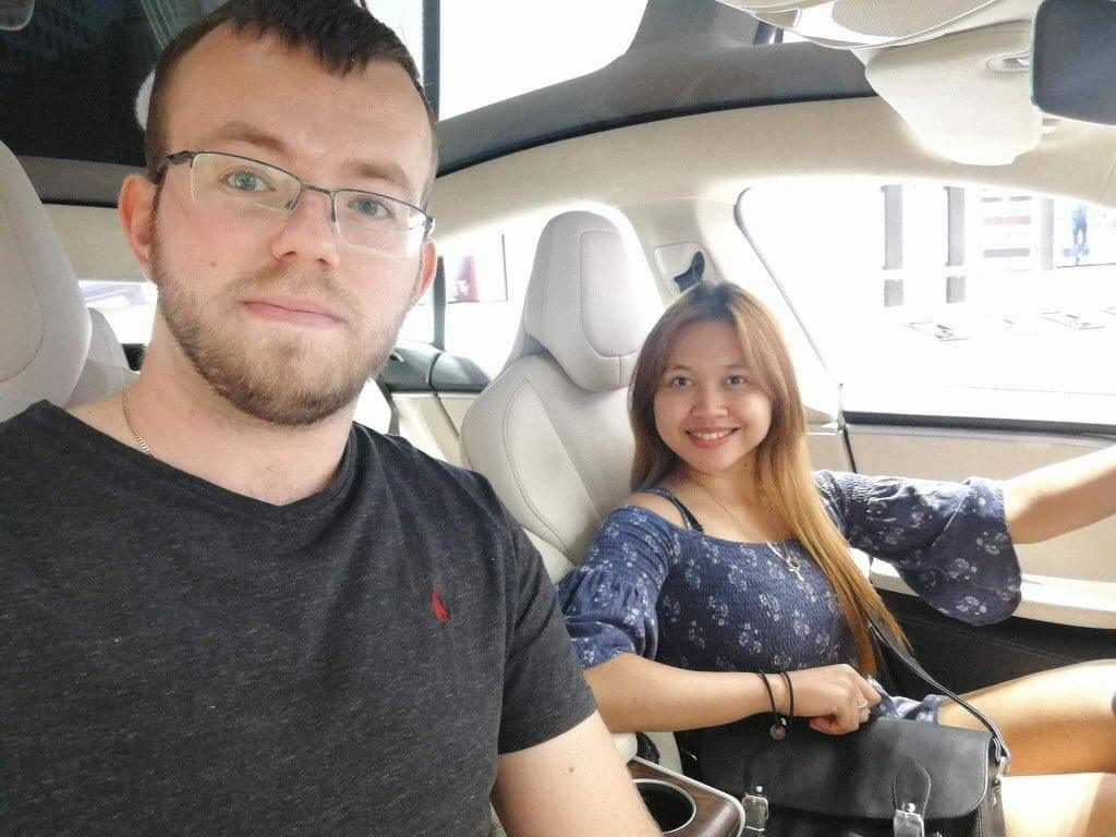me and my wife in a Tesla