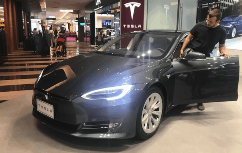 me at the Tesla showroom in Taipei, Taiwan